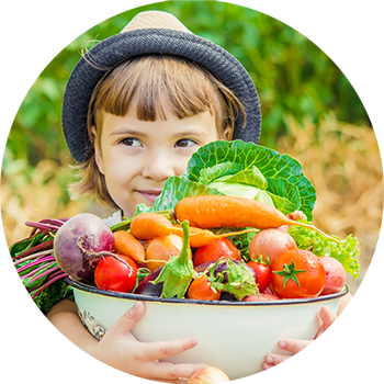 Your Health - Kid with a bowl of fresh aquaponic veggies